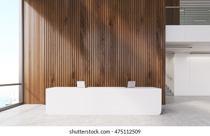 Dark wood wall near reception desk with laptops. Stairs round corner. Panoramic window. Concept of modern accounting firm. 3d rendering. Mock up
