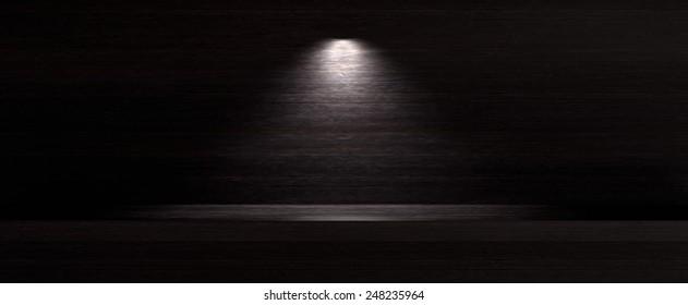 Dark wooden background with spotlight lamp
