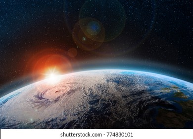 Dawn over the planet. A view from outer space to the surface of the Earth. Hurricane over the ocean. Elements of this image furnished by NASA