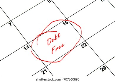Debt Free Circled on A Calendar in Red