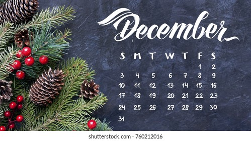 December monthly calendar. Spruce branches and cones frame. Great season texture with december and winter mood.