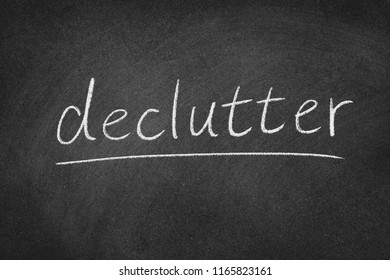 declutter concept word on a blackboard background