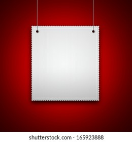 decorative blank hanging on red wall with place for text