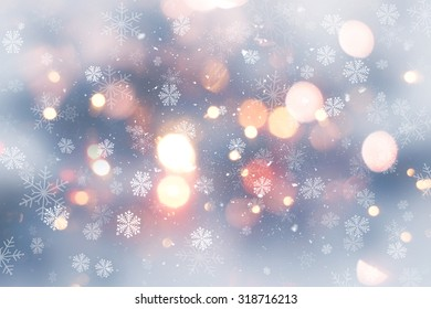 Decorative Christmas background with snow and bokeh lights