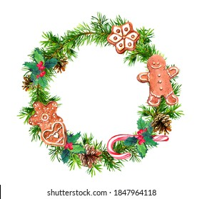 Decorative Christmas wreath with pine tree branches, ginger cookies, gingerbread man, candy cane and mistletoe. Watercolor round border