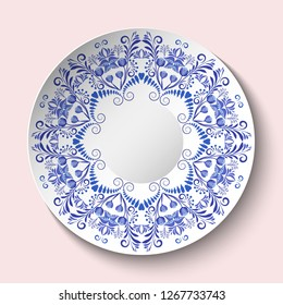 Decorative plate with blue floral ornament in a circle. Empty space in the center. The ethnic style of painting on porcelain. Rasterized version