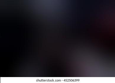 Deep rich black blur background. Matte texture. Spots of light.