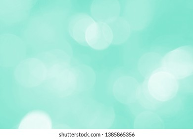 Defocused abstract background green lights. The theme of ecology, healthy lifestyle. Medicine, science, technology.