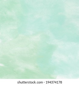 delicate blue and green background with paint stains watercolor texture