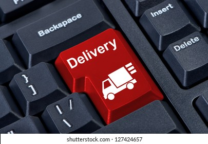 Delivery bright red button computer keyboard with car.