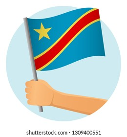 Democratic Republic of the Congo flag in hand. Patriotic background. National flag of Democratic Republic of the Congo  illustration