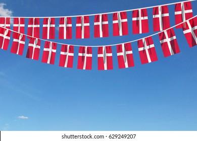 Denmark flag festive bunting against a blue sky background. 3D Rendering
