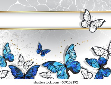 Designed with narrow, rectangular banner with gold frame and blue, realistic butterflies morpho on light gray background.