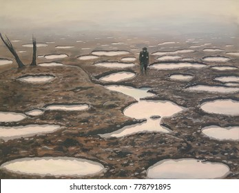 The desolate moonscape of the Passchendaele battlefield, First World War.   A soldier slogs through no man's land.  The landscape is all water filled shell holes.