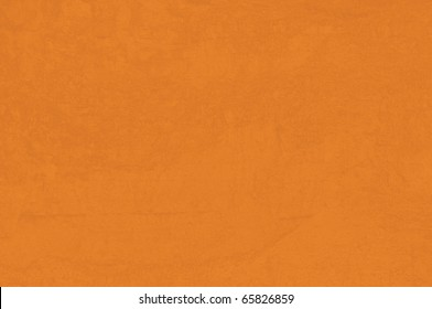 detail of cob wall with orange color and brushed