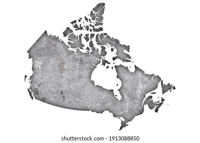 Detailed and colorful image of map of Canada on weathered concrete