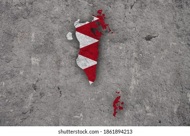 Detailed and colorful image of map and flag of Bahrain on weathered concrete