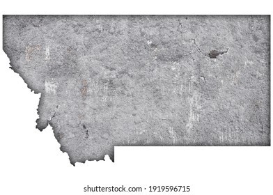 Detailed and colorful image of map of Montana on weathered concrete