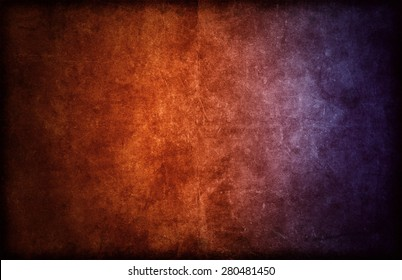 A detailed, rough background or backdrop texture graphic design with color gradient from orange to purple.