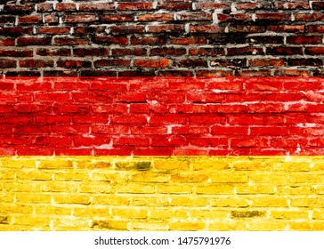 Deutschland flag painted in the style of graffiti on a brick wall