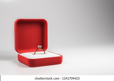 Diamond engagement ring in red box on grey background. Wedding proposal and love concept. 3D Rendering