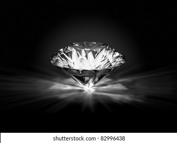 Diamond on a black background with the specks of light