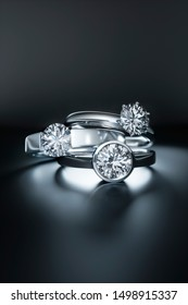Diamond rings on a black background - 3D illustration