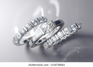 Diamond wedding set, solitaire engagement ring, half-eternity and eternity bands with bar setting, round stones, staying on white background. 3D rendering