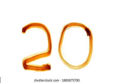 Digit 20 twenty. Two and Zero, Null. Glowing numbers. isolated on white background. Abstract  light painting. Creative artistic golden bokeh.