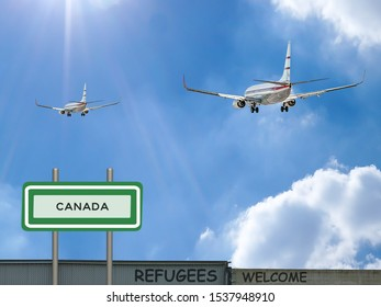 Digital composite and 3D illustration of two passenger jet airliners flying into a blue sunset sky with a sign of Canada and refugees welcomed on a wall in the foreground