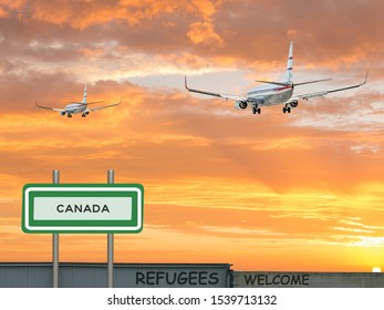 Digital composite and 3D illustration of two passenger jet airliners flying into a beautiful red sunset sky with a sign of Canada and refugees welcomed on a wall in the foreground