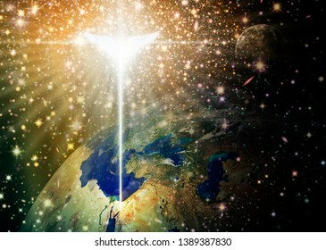 Digital illustration of the Christmas star and angel shining down over Bethlehem, as viewed from outer space. Space and stars are digitally illustrated. Credit NASA for earth and moon images.