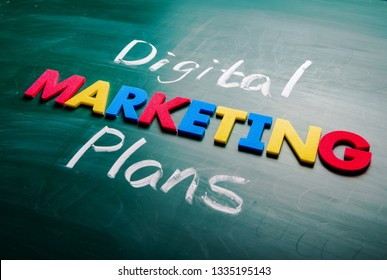 Digital marketing plans concept. Colorful and handwriting words on blackboard.