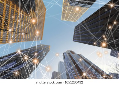 Digital network connection lines of architectures, skyscrapers in Chicago City with blue sky, Illinois, USA