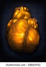 digital painting of a human heart made of gold