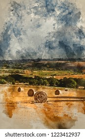 Digital watercolour painting of Beautiful moody Summer landscape of field of hay bales with dramatic stormy clouds overhead in English countryside