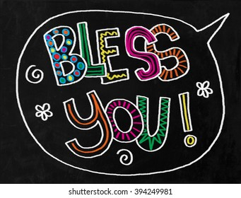 A digitally created chalkboard with hand drawn text which says BLESS YOU.