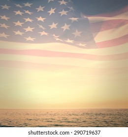 Digitally generated american flag rippling against beautiful sunset on a sunny day