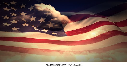 Digitally generated american flag rippling against bright blue sky with clouds