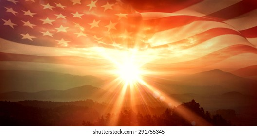 Digitally generated american flag rippling against sunrise over mountains