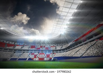 Digitally generated croatia national flag against football stadium with fans in white