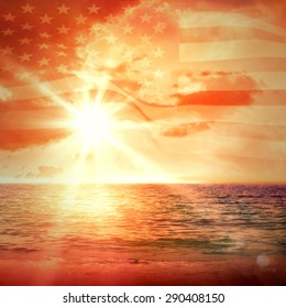 Digitally generated united states national flag against sunrise over magical sea