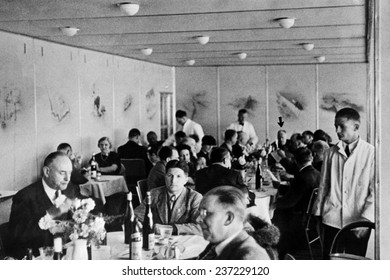 Dining 2000 feet in the air on the Hindenburg with wine on every table Dr.Hugo Eckener, the manager of the Luftschiffbau Zeppelin, May 10, 1936.