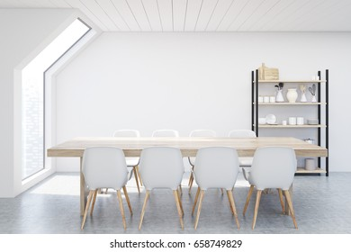 Dining room in an attic with white walls, a long wooden table with white chairs around it and a cupboard in the background. 3d rendering, mock up