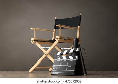Director Chair, Movie Clapper and Megaphone on a wooden floor. 3d Rendering