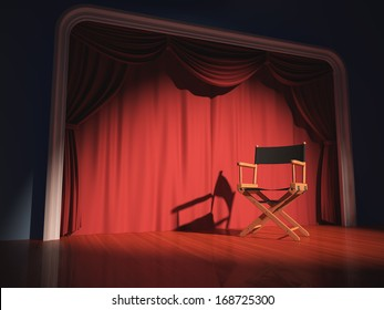 Director's chair on the stage illuminated by floodlights.