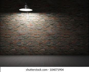Dirty brick wall illuminated by lamp