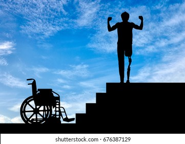 Disability and rehabilitation. Happy disabled man with a prosthetic leg walked up the stairs, and a wheelchair