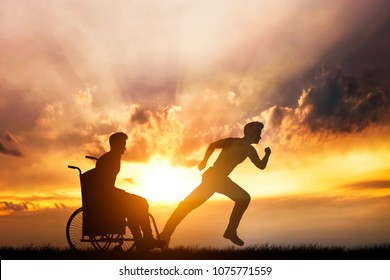 Disabled man in a wheelchair dreaming of running again. Impaired person's obstacles. Dreams and hopes.