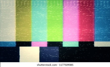 A distorted tv transmission or VHS tape, a dark noisy signal of SMPTE color bars (a television screen test pattern).